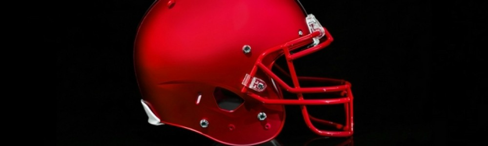 A sideview of a red american football helmet