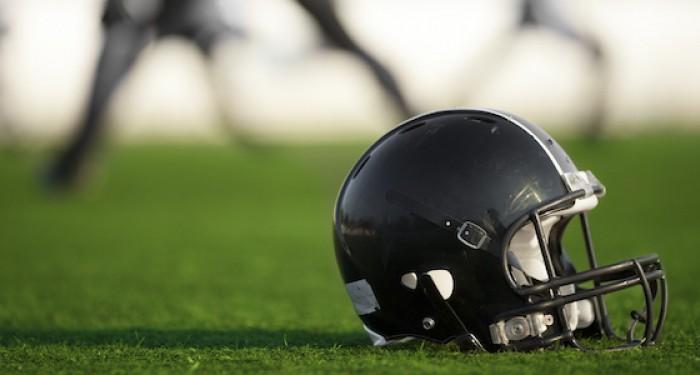 American football helmet on grass