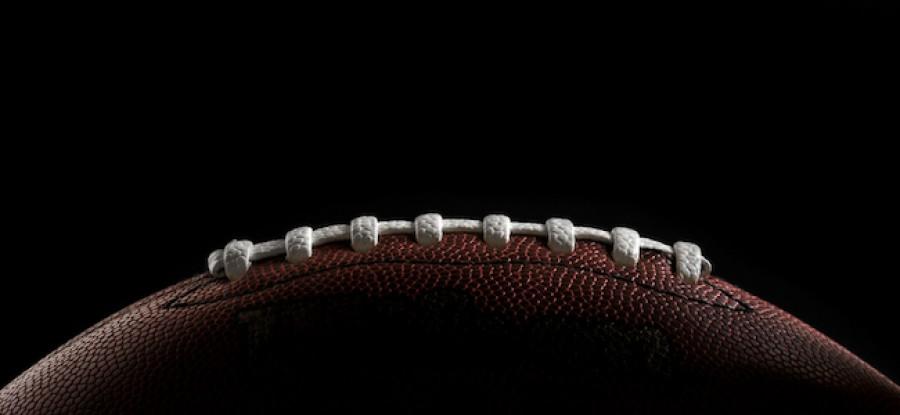 American football on black background