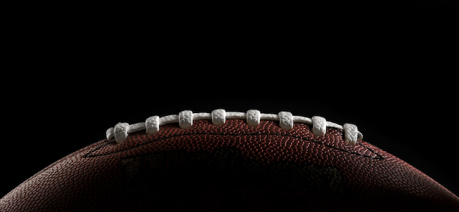 American football on black background
