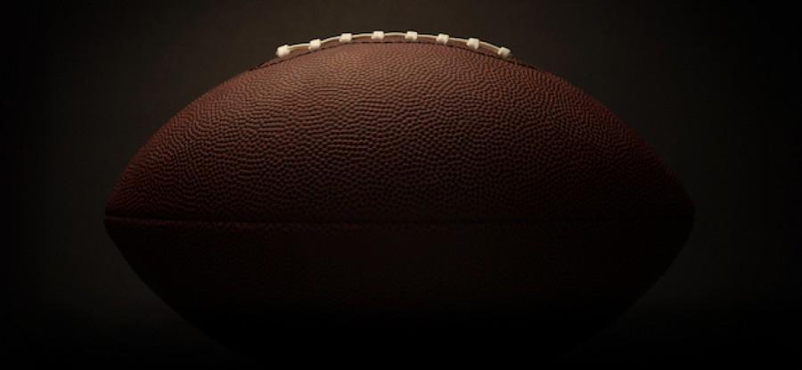 American football on dark background