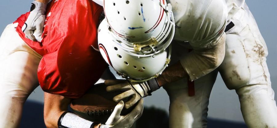 American Football players tackling
