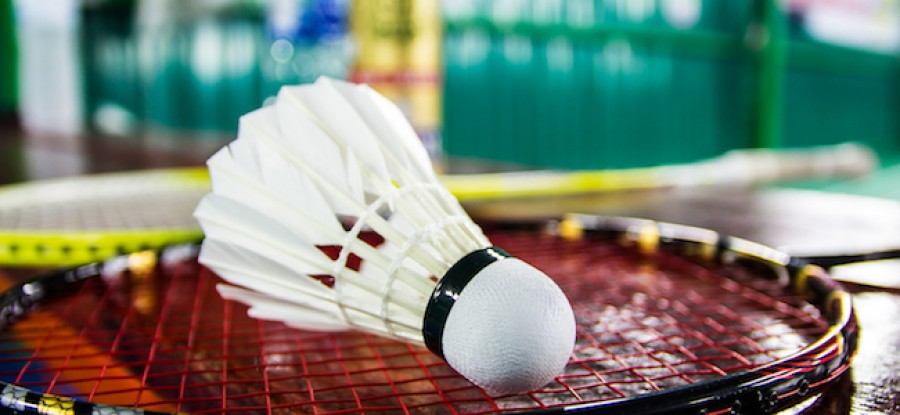 Badminton shuttle on racket