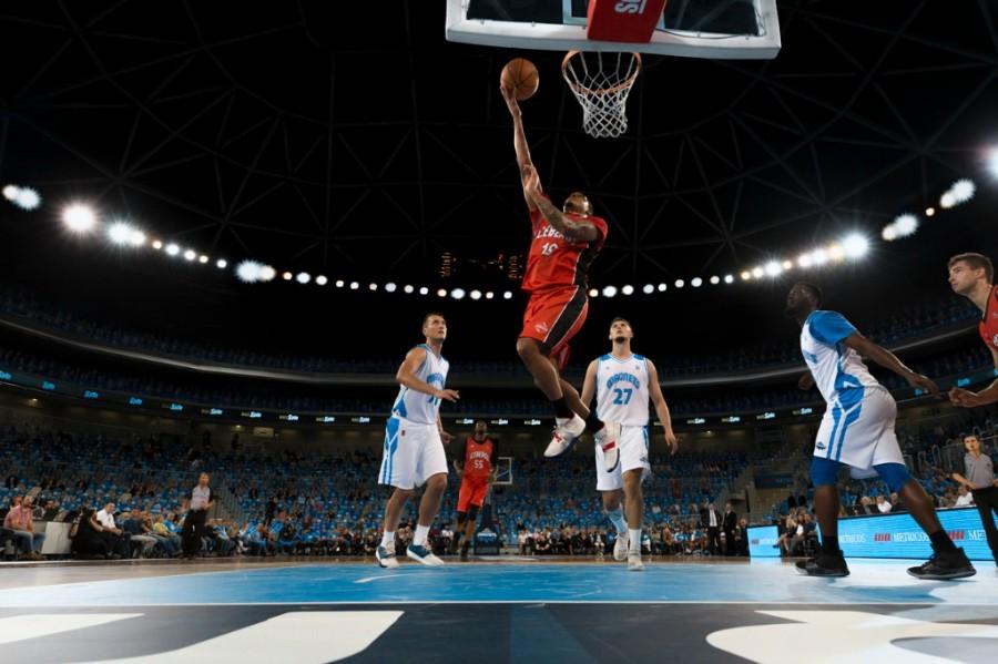 Basketball player finishing with a layup