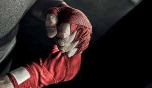 Fighter wrapping red bandage