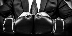 Boxing gloves on businessman in suit