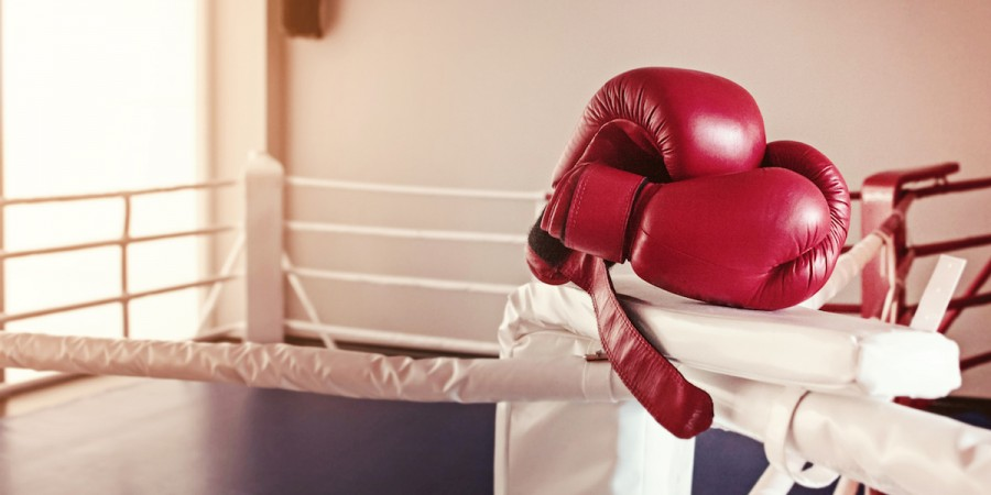 Boxing gloves by boxing ring
