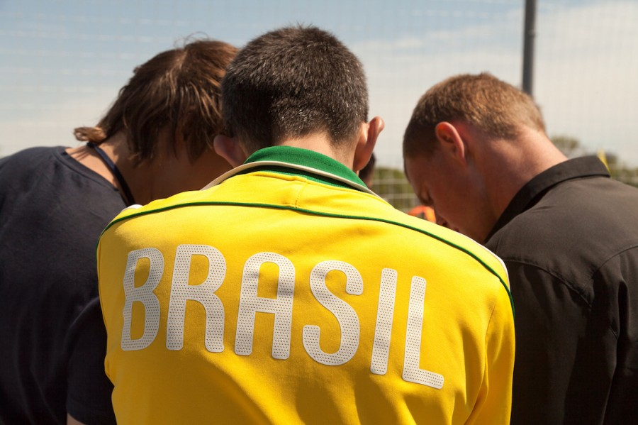 Brazil players and coaches huddled around to discuss strategy