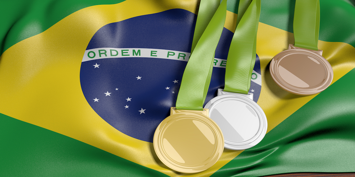 Brazilian flag with Olympic medals