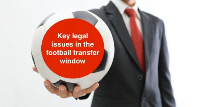 Businessman_holding_a_soccer_ball_on_white_background_key_legal_issues