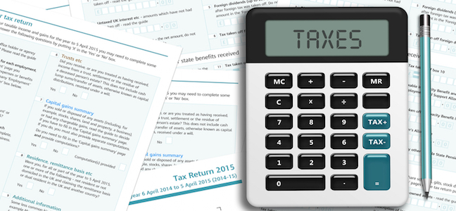 Calculator on UK tax papers