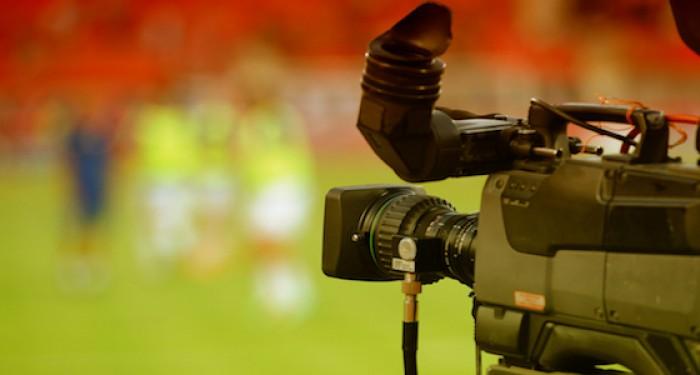 Camera filming on sports field