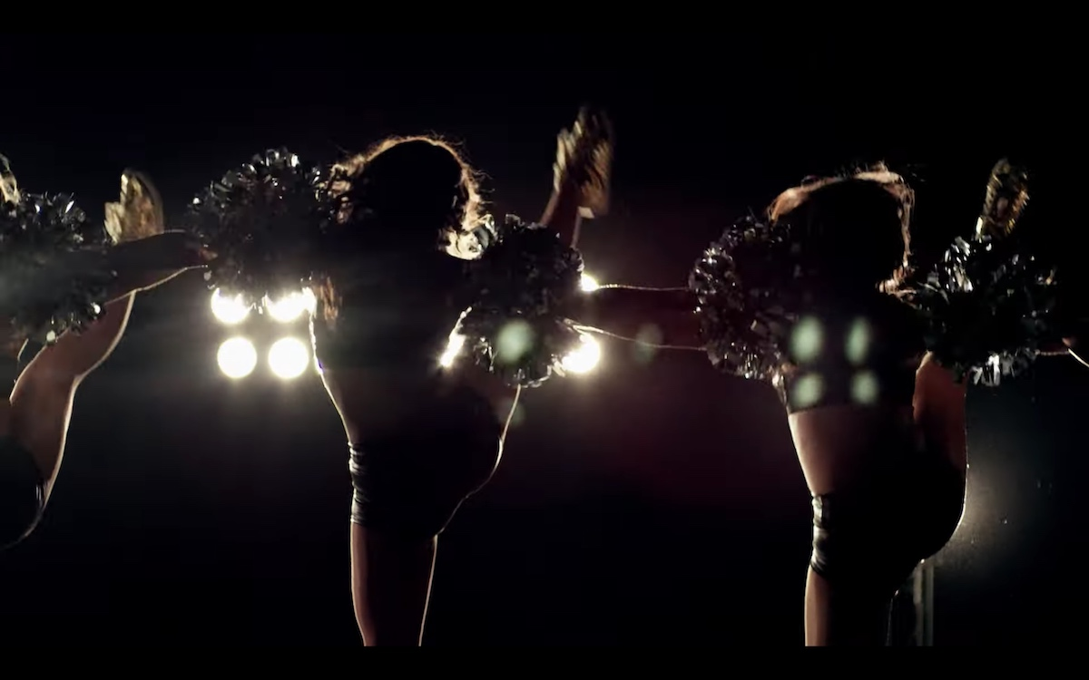 Still image of cheerleader from A Woman's Work: The NFL's Cheerleader Problem (2021) documentary