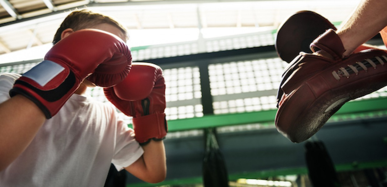 Child in a boxing training session