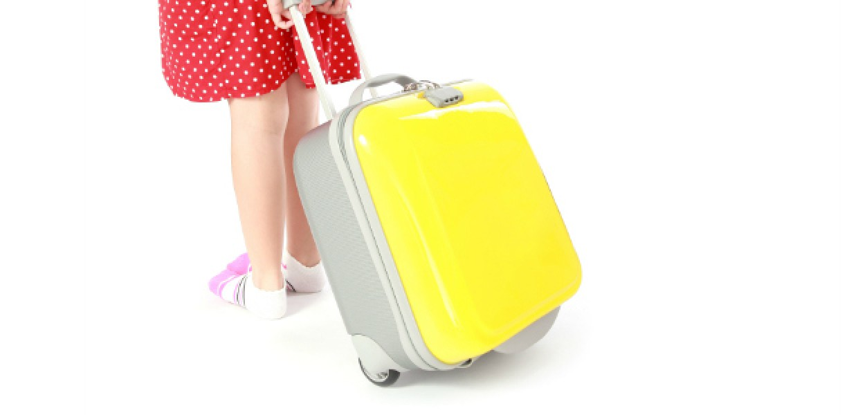 Child_with_Yellow_Suitcase