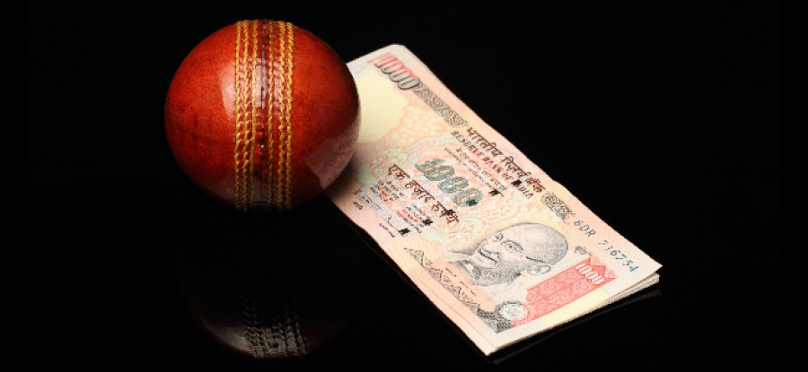 Cricket Ball next to cash