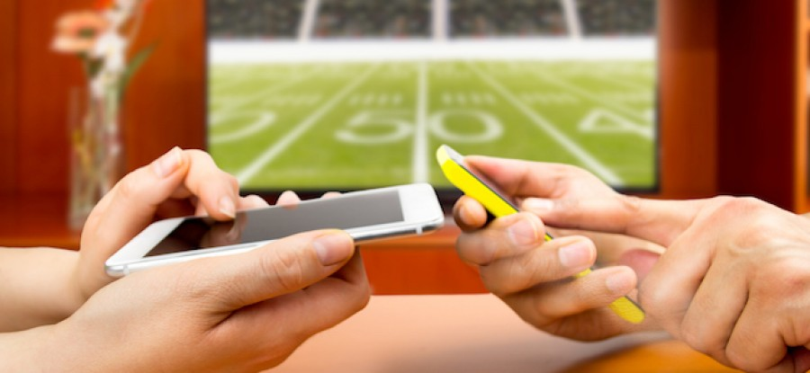 Fans engaging with football on their phones
