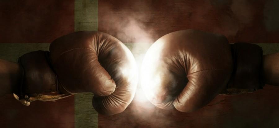 Boxing gloves in front of Denmark flag