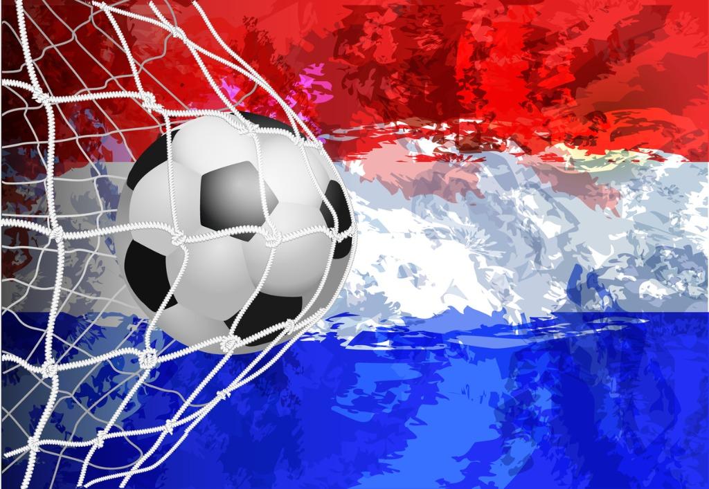Dutch flag on football hitting back of net