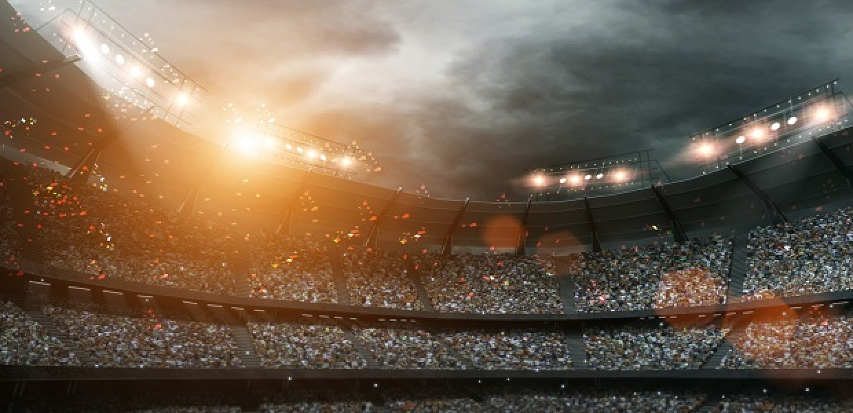 Fans in sports stadium in the evening