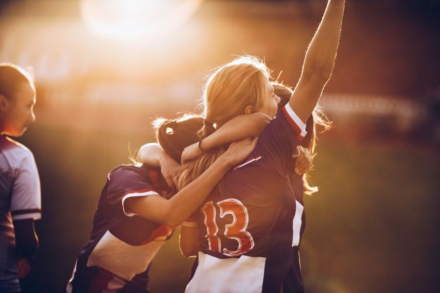 Image of female footballer's celebrating a goal