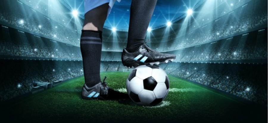 Foot_on_Football_In_Stadium
