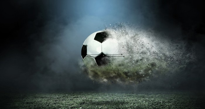 Ball dissolving in air over a football pitch