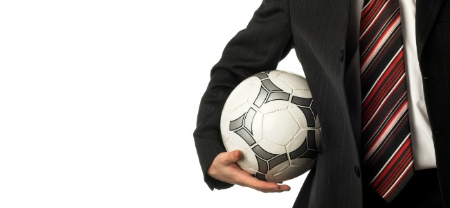Football_Being_Carried_By_Man_In_a_Suit