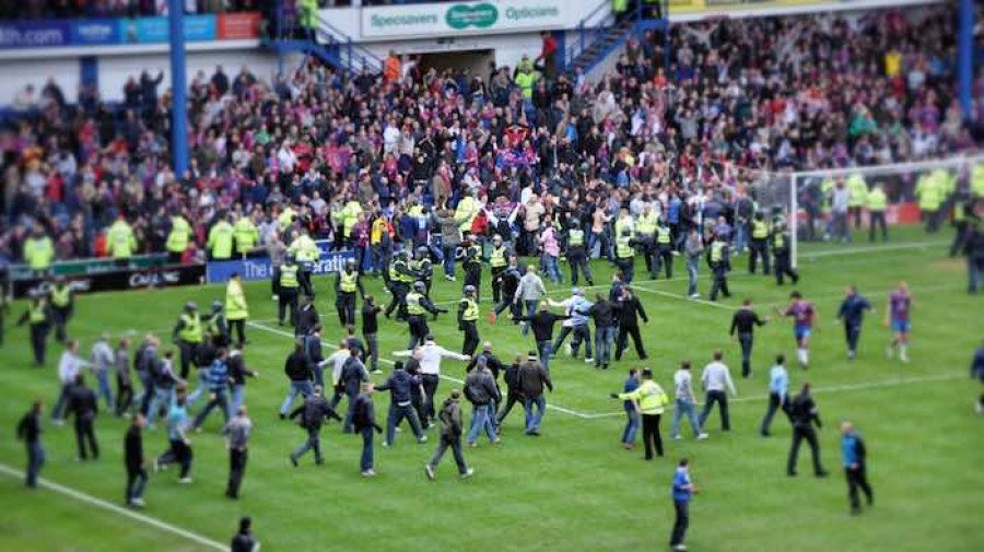 Football fans invading pitch