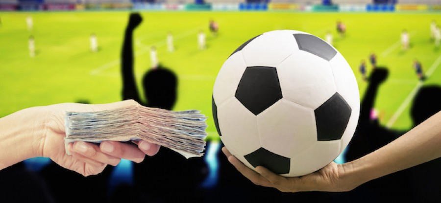 Football being exchanged for money