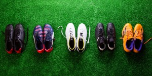 Football boots on grass