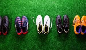 Football boots on grass
