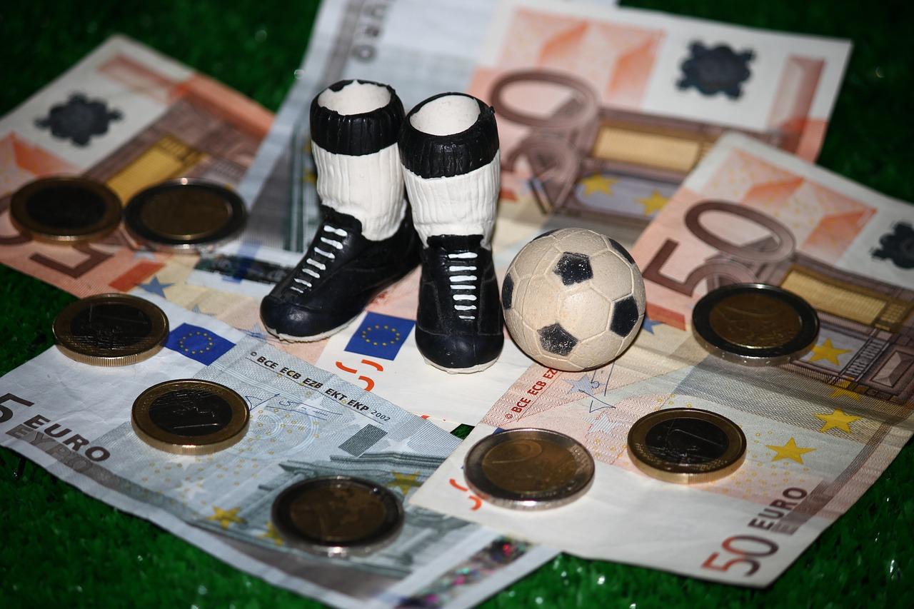 Football boots on money