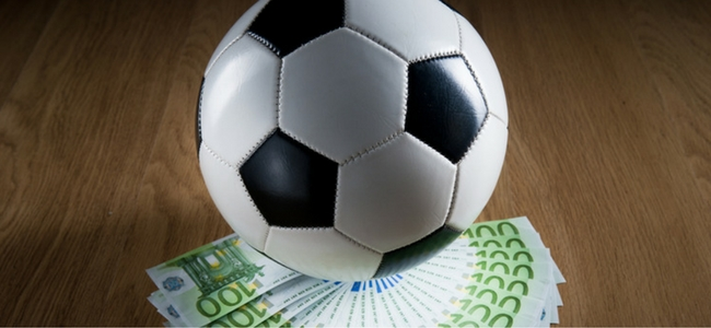 """When does a buy-out clause trigger a """"transfer"""" under FIFA Regulations?"""