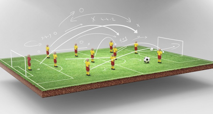 Football strategy illustration above floating football field
