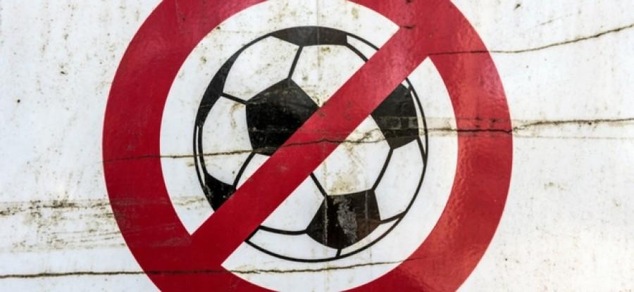 Football inside of a no sign