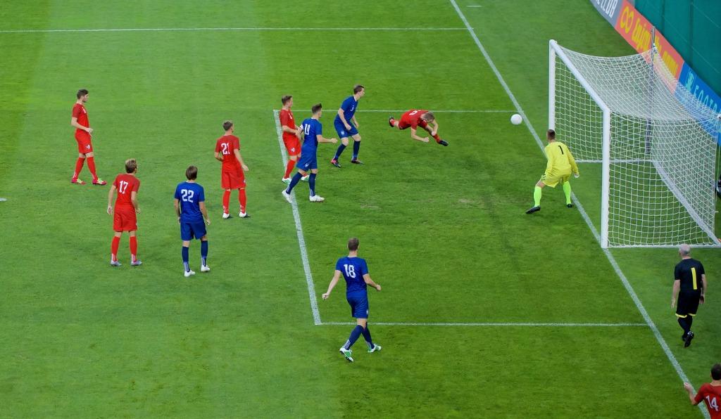 Footballer Heading Ball In Goal