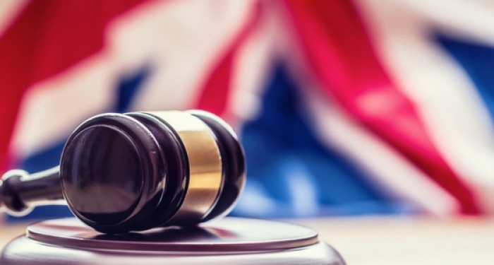 Gavel in front of UK Flag