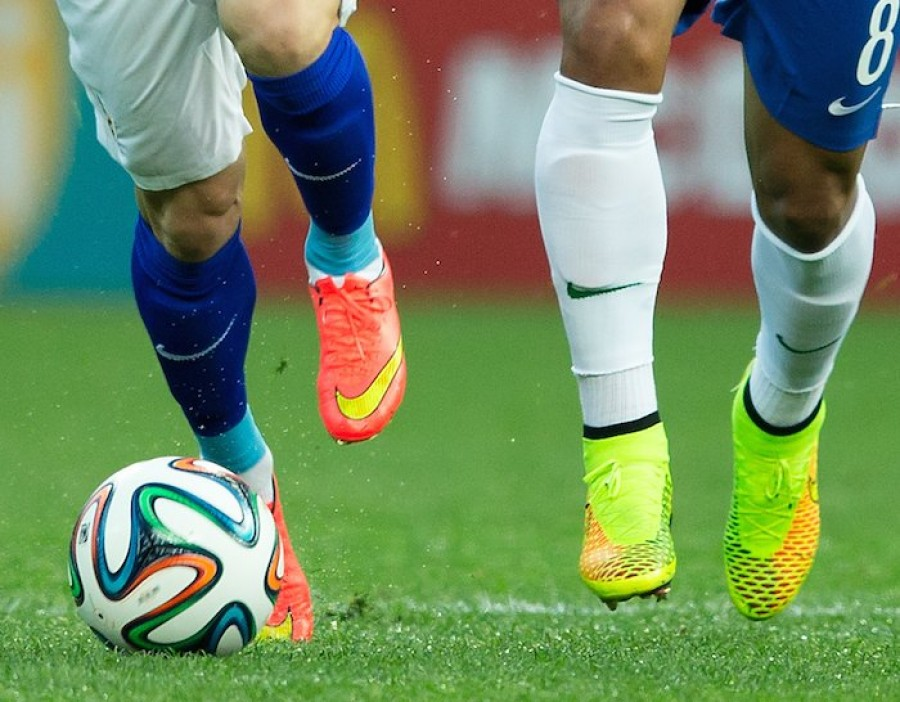 Footballers with ball at feet