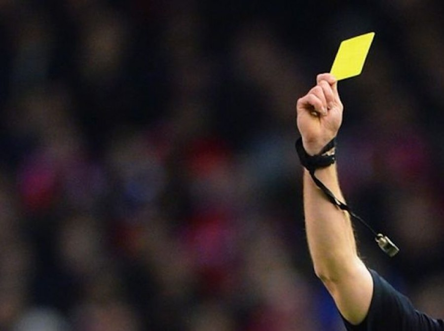 Referee_Showing_Yellow_Card.