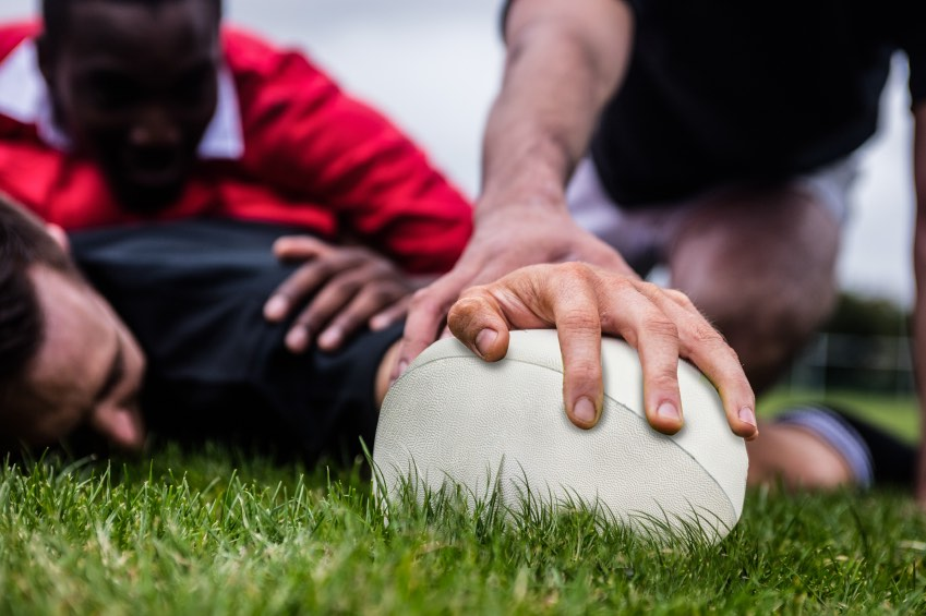 Image of rugby player scoring a try
