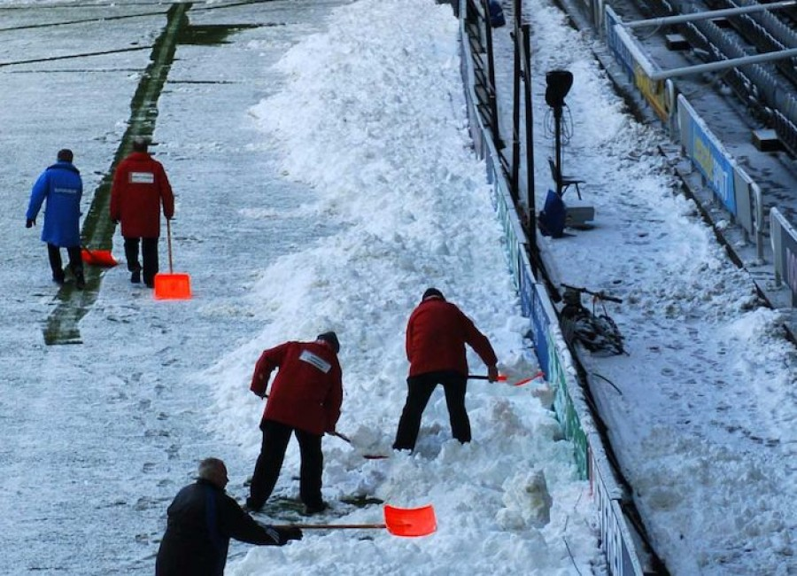 Groundsmen clearing Snow