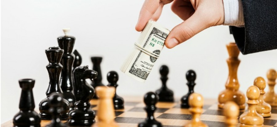 Hand_Passing_Money_Over_Chess_Game