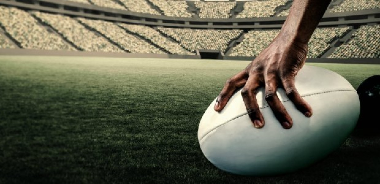 Hand_on_Rugby_Ball