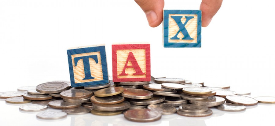 Hand placing tax blocks on coins