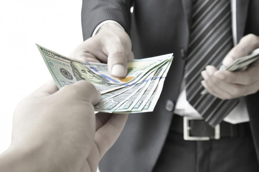 Hands giving and receiving money