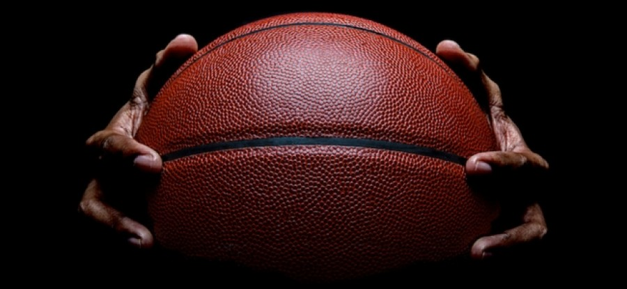 Hands holding basketball
