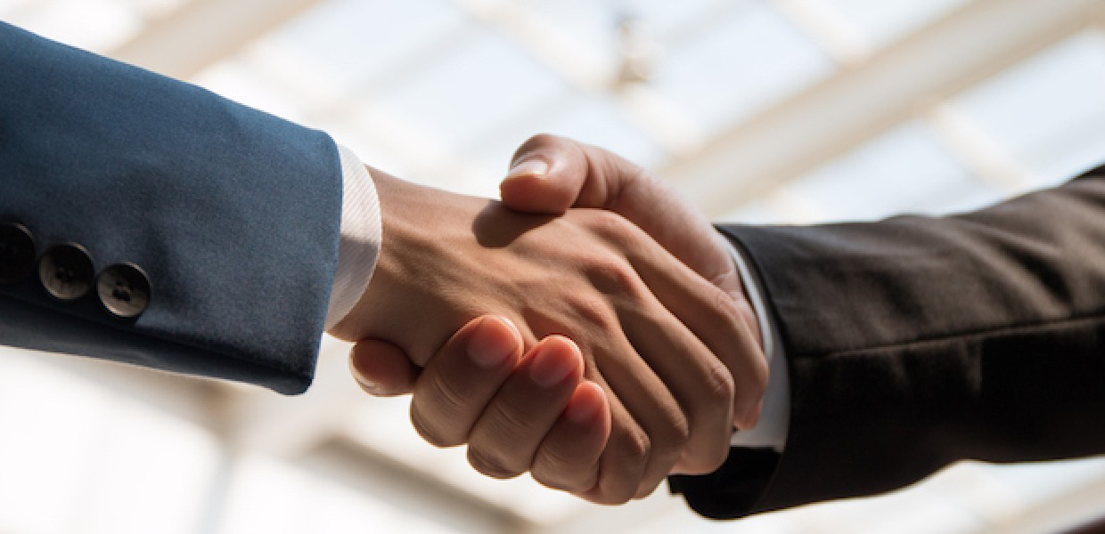 Handshake to show a dispute being resolved