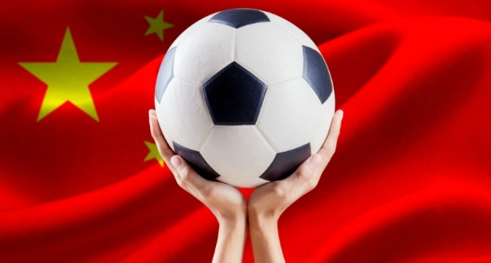 Holding_Football_in_Front_of_Chinese_Flag