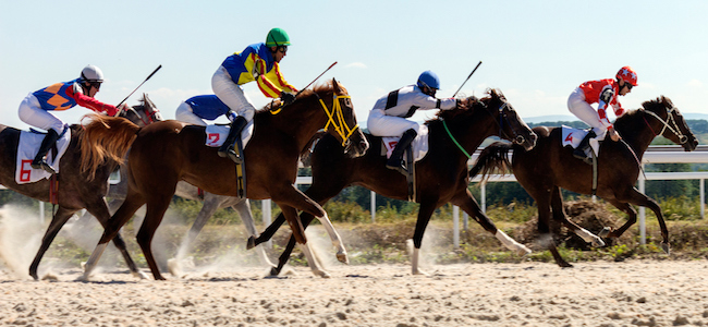 Riders_on_horses_racing_during_competition